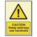 CAUTION STEEP STAIRWAY. USE HANDRAILS